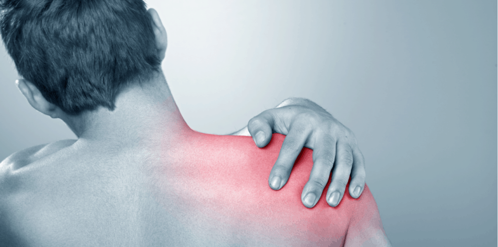 Man clutching shoulder in pain